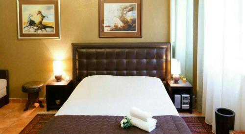 Кровать или кровати в номере Verdi Apartment