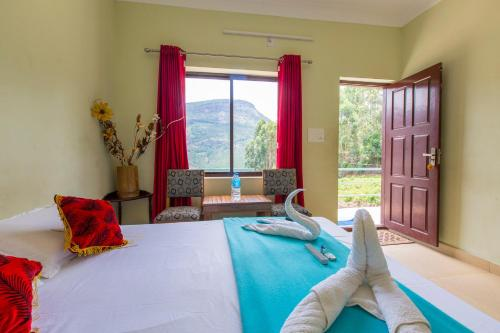 A bed or beds in a room at Mountain Hut Resorts