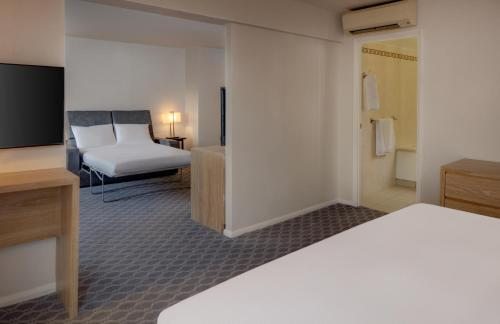 A bed or beds in a room at Hilton London Watford