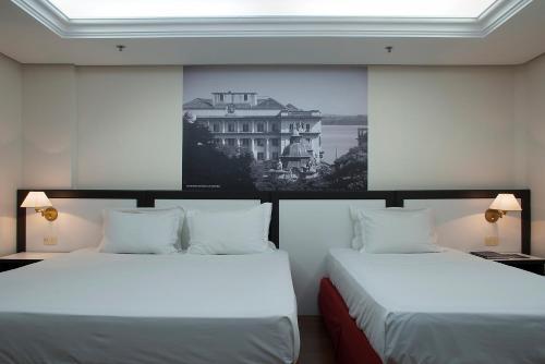 Cama ou camas em um quarto em Master Grande Hotel - Centro Histórico