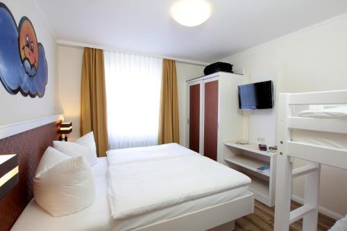 Кровать или кровати в номере Park Hotel Sellin
