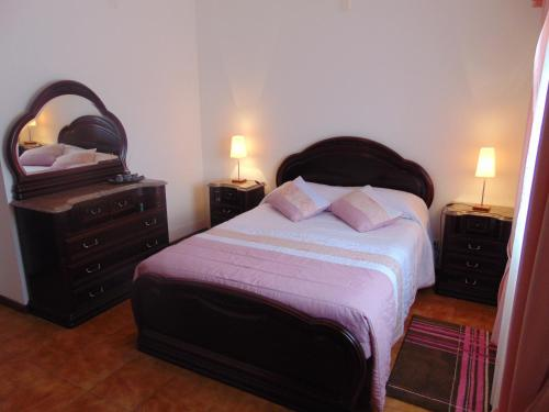 A bed or beds in a room at Casa da Sogra