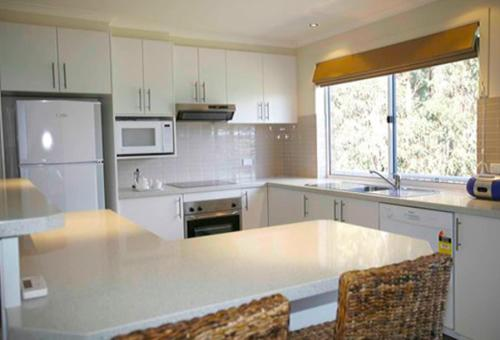 A kitchen or kitchenette at Waterview Luxury Apartments