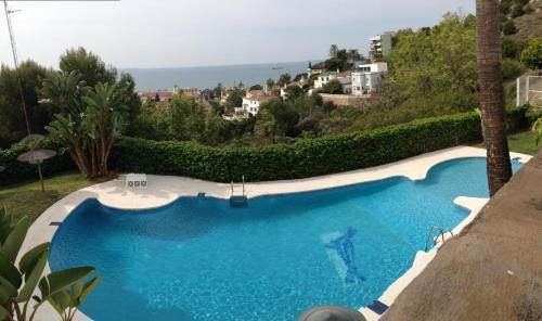 A view of the pool at Apartamento con 3 piscinas vistas al Mar or nearby