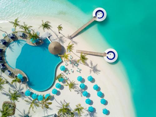 A view of the pool at Kandima Maldives or nearby
