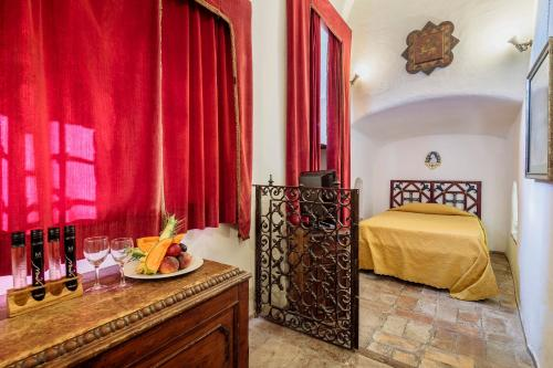 A bed or beds in a room at Castello Orsini Hotel