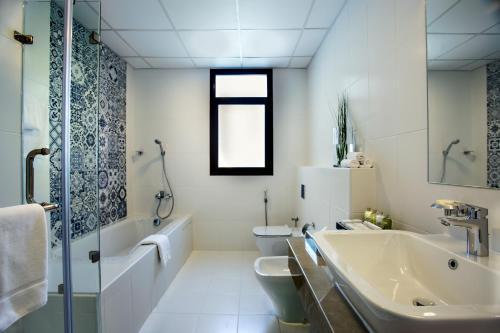 A bathroom at The Grove Resort Bahrain