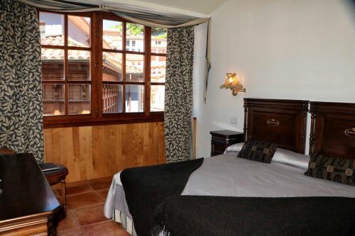 A bed or beds in a room at La Casona de Pío