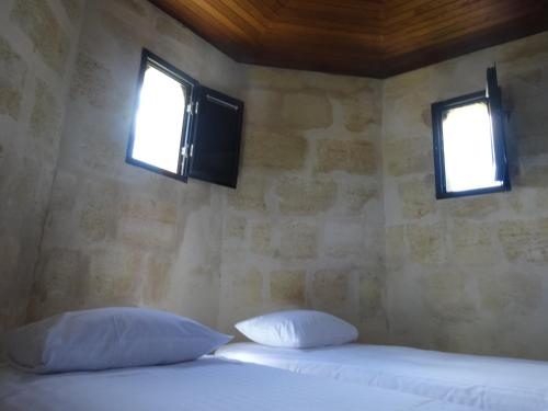 A bed or beds in a room at Chateau Camiac