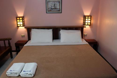 A bed or beds in a room at Blue Coral Resort Boracay