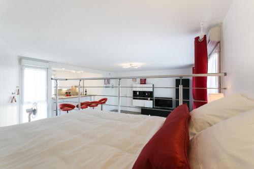 Un ou plusieurs lits dans un hébergement de l'établissement La Marquise - Montpensier