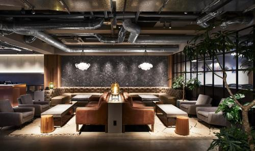 A restaurant or other place to eat at The Millennials Kyoto