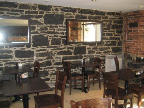 Restaurant ou autre lieu de restauration dans l'établissement Le Relais Lyonnais