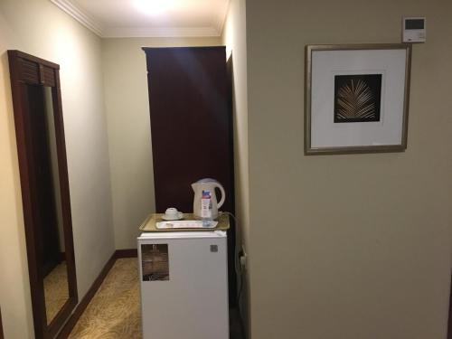 مطبخ أو مطبخ صغير في ديباج للأجنحة الفندقية 2
