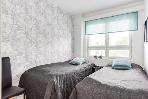 Vuode tai vuoteita majoituspaikassa Apartment Pohjanpoika