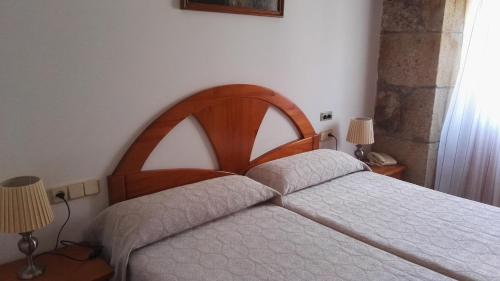A bed or beds in a room at Hostal Continental
