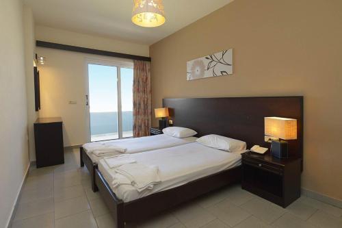 Un ou plusieurs lits dans un hébergement de l'établissement Ialysos City Hotel