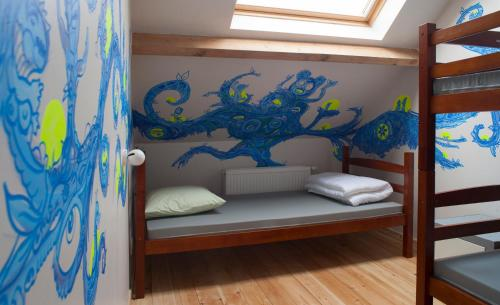 A bunk bed or bunk beds in a room at KaBa Hostel