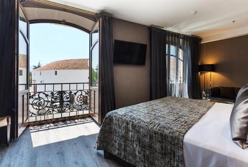 Letto o letti in una camera di Catalonia Ronda