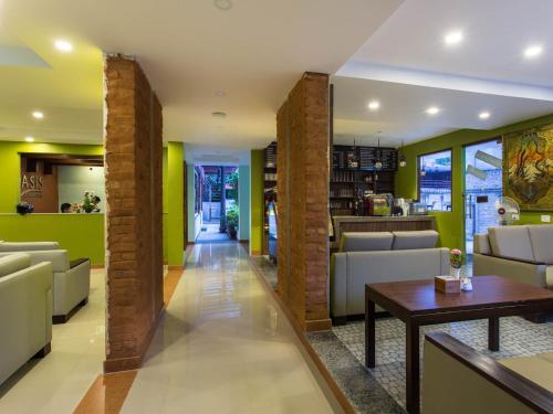 The lobby or reception area at Oasis Kathmandu Hotel