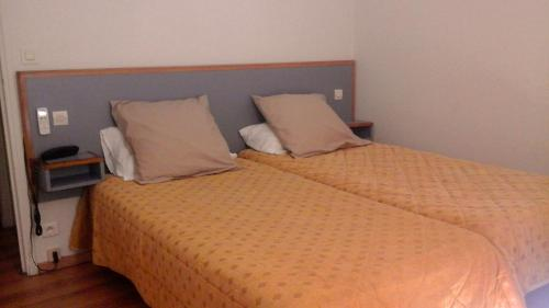 A bed or beds in a room at Hotel Boreal