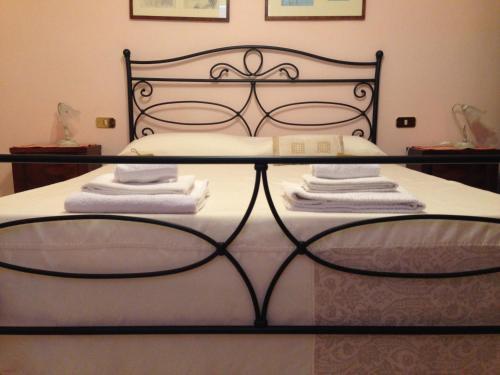 Letto o letti in una camera di Bed and Breakfast Il Cappero