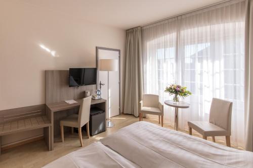 Кровать или кровати в номере Hôtel de la Rose