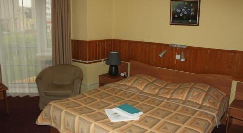 Кровать или кровати в номере Отель Центр 300