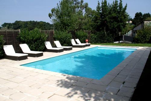 The swimming pool at or near Hotel De La Poste