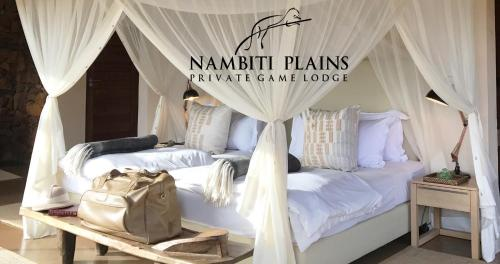 A bed or beds in a room at Nambiti Plains