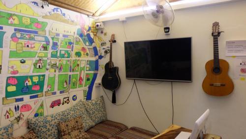 Una televisión o centro de entretenimiento en Counting Sheeps at CNX
