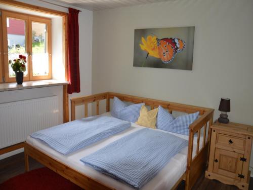 Ein Bett oder Betten in einem Zimmer der Unterkunft Landgasthaus Mittelallgäu