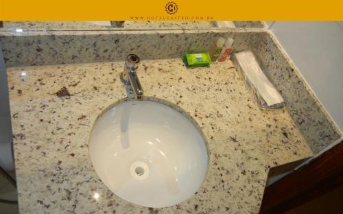 Um banheiro em Hotel Castro