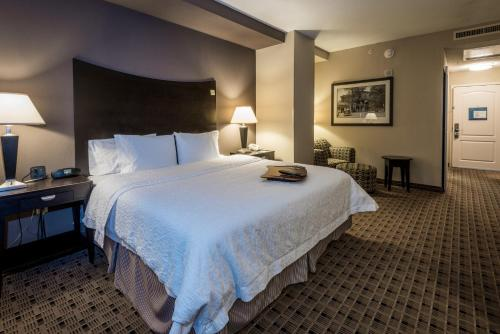 A bed or beds in a room at Hampton Inn & Suites Montgomery-Downtown