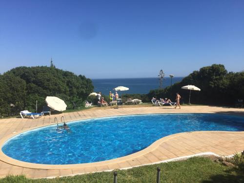 The swimming pool at or near Vivenda Jardim Mar Algarve Porches