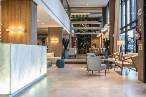 The lobby or reception area at Interclass Hotel Criciuma