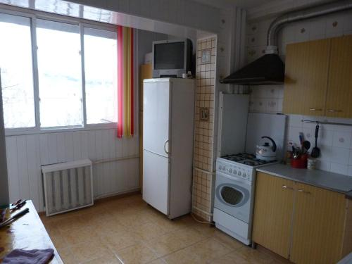 A kitchen or kitchenette at Apartment in Centre on Andreya Gubina