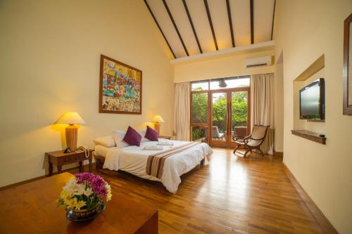 A bed or beds in a room at The Hotel @ Tharabar Gate