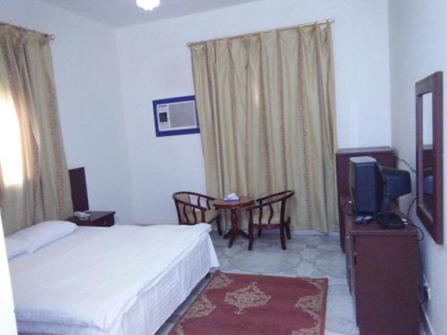 Cama ou camas em um quarto em Tathleeth Palace