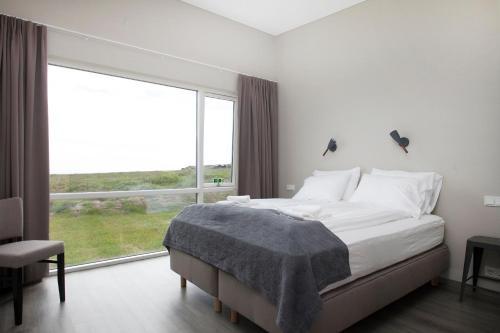 Un ou plusieurs lits dans un hébergement de l'établissement Arnarstapi Hotel