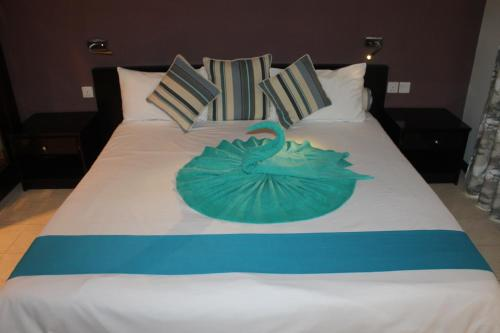 A bed or beds in a room at Grand Bay Suites