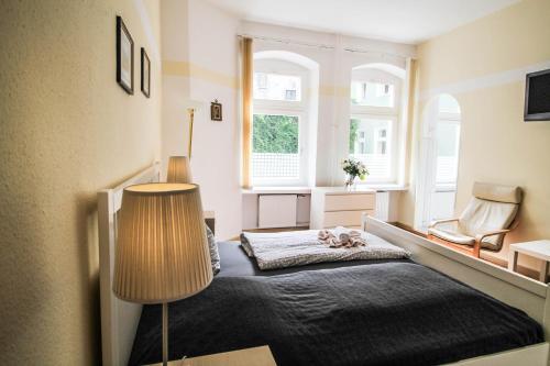 Ein Bett oder Betten in einem Zimmer der Unterkunft Kolo 77