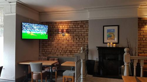 A television and/or entertainment center at Glan-Neigr Bar