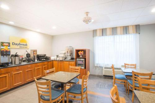 A restaurant or other place to eat at Days Inn by Wyndham Evans Mills/Fort Drum