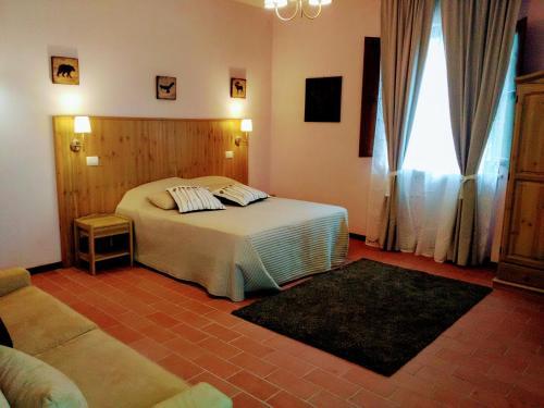 Letto o letti in una camera di BioCampus La Roccaccia - Universita' Agraria di Tarquinia