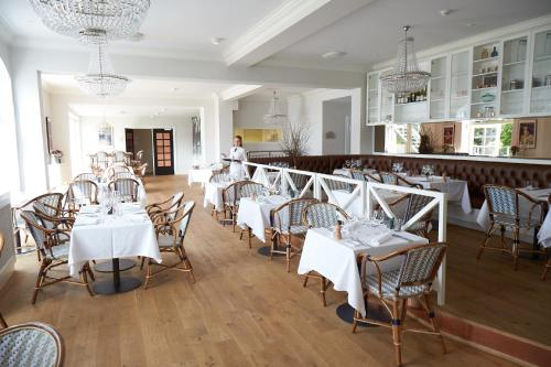 En restaurant eller et andet spisested på Stella Maris Hotel de Luxe