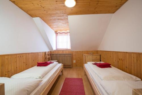 A bed or beds in a room at Mountain Hotel Bilíkova Chata