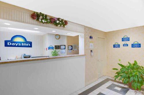 The lobby or reception area at Days Inn by Wyndham Auburn/Finger Lakes Region