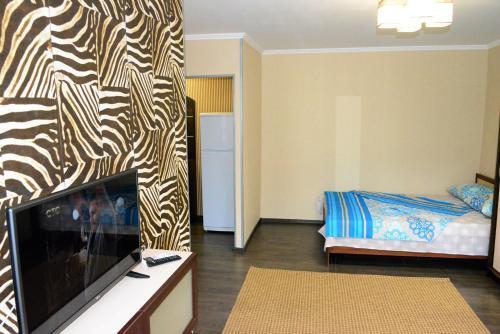 Кровать или кровати в номере BestFlat24 Letnaya