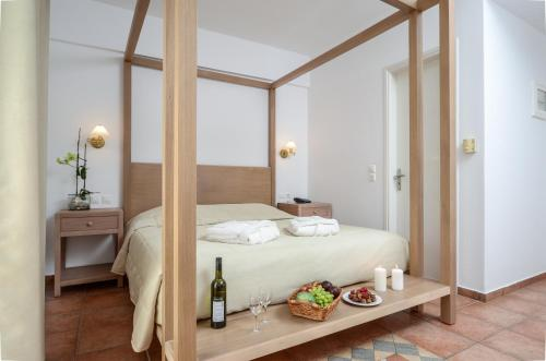 A bed or beds in a room at Astir Of Naxos